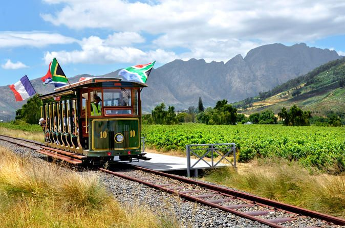 Full-Day Franschhoek Wine Tram Experience from Cape Town Experience a unique and leisurely journey through rolling vineyards in an open-side tram and open-air tram-bus stopping in at some of South Africa's oldest and most distinguished wine estates.Discover the true essence of the Franschhoek Valley – picturesque vineyards, breathtaking scenery, warm hospitality, fine wines and cuisine, and a 300-year-old history. Experience a unique and leisurely hop-on hop-off journey throug...