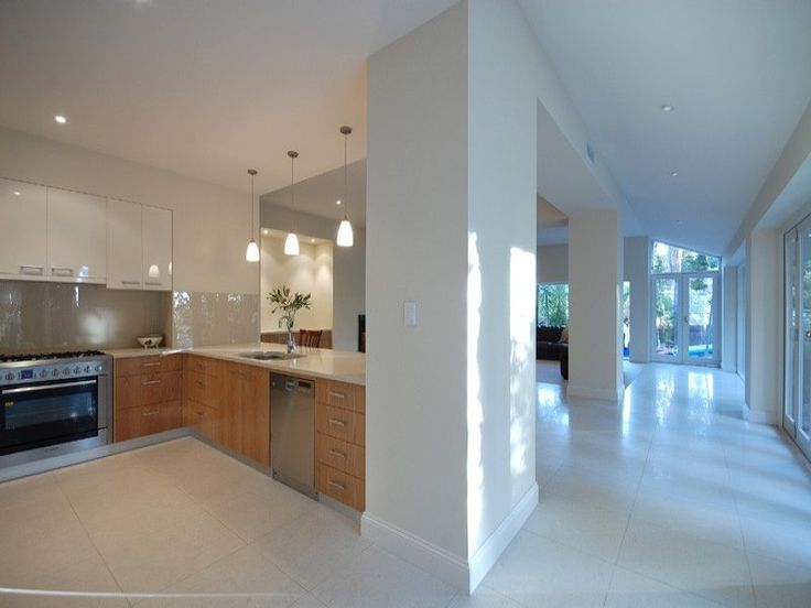 Spacious, but warmth of timber offsets the stark tiles.    Tagged as Kitchen. More inspiration at www.spaced.com.au