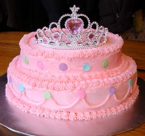 Princess Tiara Birthday Cake.  This would be so easy to make.  Dollar Store Tiara...and away we go!  Dollar Store has princess wands that I can visualize stuck in the top of the cake (one for each year) to replace sparklers.  Candles could be easily placed on the top of the first tier (facing the front).