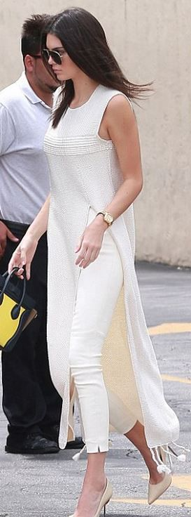 Who made Kendall Jenner's nude pumps, fringe maxi tunic top, white pants, and print handbag?