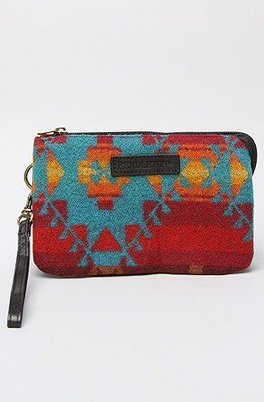 """Pendleton The Three Pocket Keeper in Red Multi by Pendleton. $38.00. Manufactured by Pendleton.. A brand-new, unused, and unworn item (including handmade items) in the original packaging (such as the original box or bag) and/or with the original tags attached.. Pendleton The Three Pocket Keeper in Red Multi. Allover printed wristlet with zip closure; applique logo on front; 3 interior pockets, 1 with zip closure; 100% wool body, 100% polyester lining. 4.75"""" H..."""