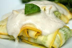 Paleo ravioli.  4-5 medium to large yellow squash 1 Tbsp. olive oil 1.5 lbs. ground chicken 1 8 oz. bag frozen spinach, thawed 8 oz. mascarpone cheese 1/2 yellow onion, diced 1 clove garlic, minced small handful fresh basil leaves salt and pepper to taste Caulif-redo Sauce
