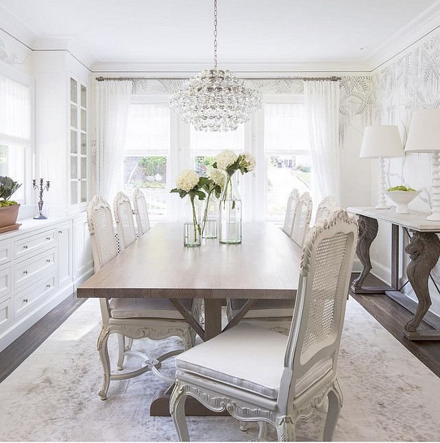White Dining Room With Cane Chairs And Built In Cabinets Martha OHara Interiors