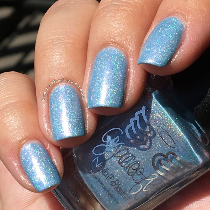 Grace-full - Tickled by Wings – a mid blue pastel linear holo with a pink shift.