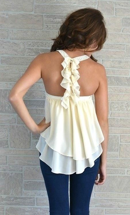 The back of this shirt is absolutely beautiful! I love how flowy and light it looks. I wish the picture linked to a store :/