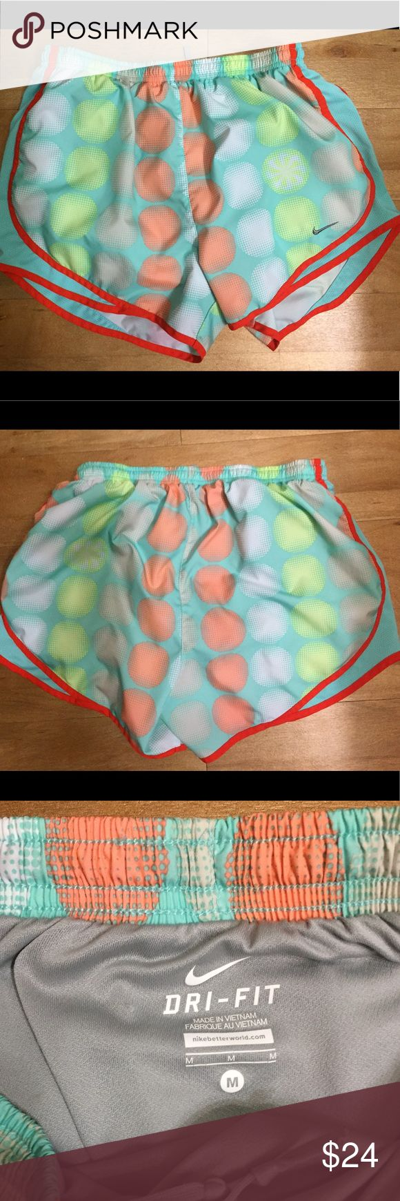 Nike Tempo Running Shorts polka dot medium Nike Tempo Running Shorts in medium. Turquoise shorts with white, gray, peach, and mint green polka dots along with red trim. Perfect condition. Like new. Nike Shorts