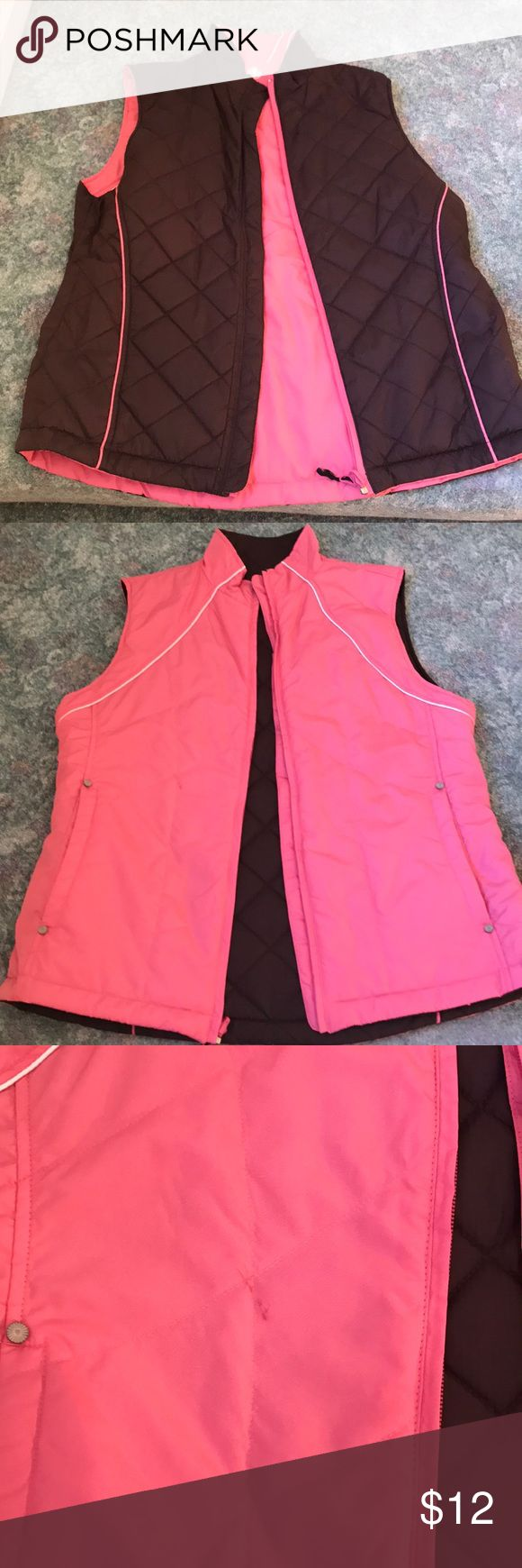 Sun mountain reversible bubble vest Size large pink and chocolate brown reversible bubble vest. Small stain can be seen on photos on the one side. Other side in great condition sun mountain Jackets & Coats Puffers