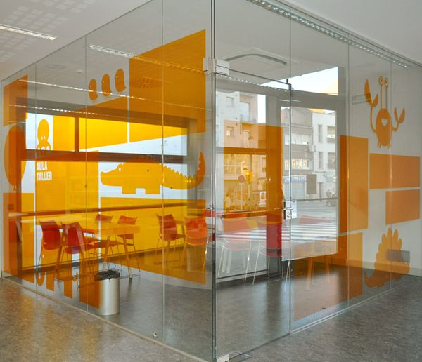 Biblioteca del Sud signage system. Lovely use of window graphics - could make a meeting room or cafe completely unique