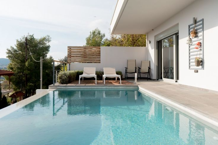 Villa Irida is a 4 bedroom luxury stylish property with private pool situated at Lagonisi area in the neighborhood of Agios Dimitrios, a quiet spot with amazing sea views, serenity and privacy. The beach is only 5 minutes drive from the Villa.
