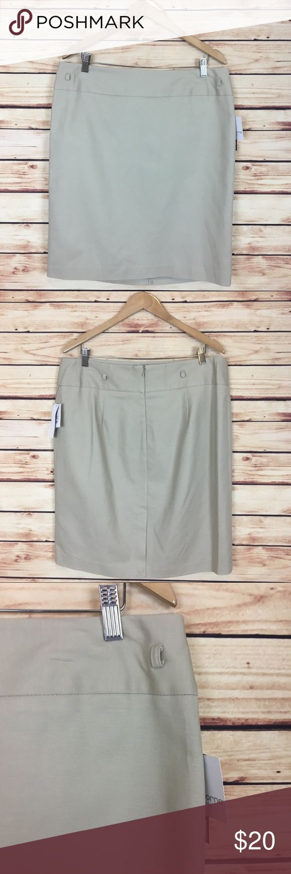 """NWT Liz Claiborne Tan Khaki Pencil Skirt Size 16 Liz Claiborne pencil skirt. Tan. Back slit. Back zipper. Belt loops, no belt included. Size 16.  New with tags and no flaws.  Measurements are approximately: 36"""" waist, 44"""" hips, and 23.5"""" length.  98% cotton 2% spandex. Polyester lining.  No trades. All items come from a pet friendly home. Bundle to save! Liz Claiborne Skirts Pencil"""