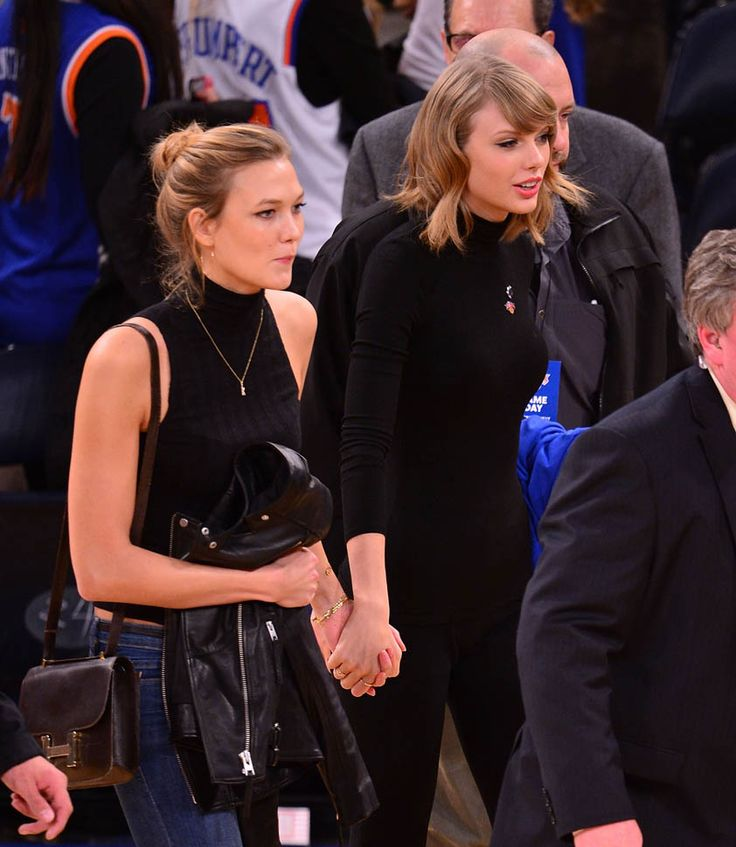Twitter is buzzing about a pic taken at Matt Healy concert of Taylor Swift and Karlie Kloss that looks like they are kissing. Angel wings, blue eyes, bondage, broken heart jewelry worn by Selena Gomez at 2014 AMAs about Taylor Swift & Karlie Kloss (Victoria's Secret angel wings)? Don't know about others, but, I don't hold hands with my girlfriends (not since grade school, anyway. LOL)