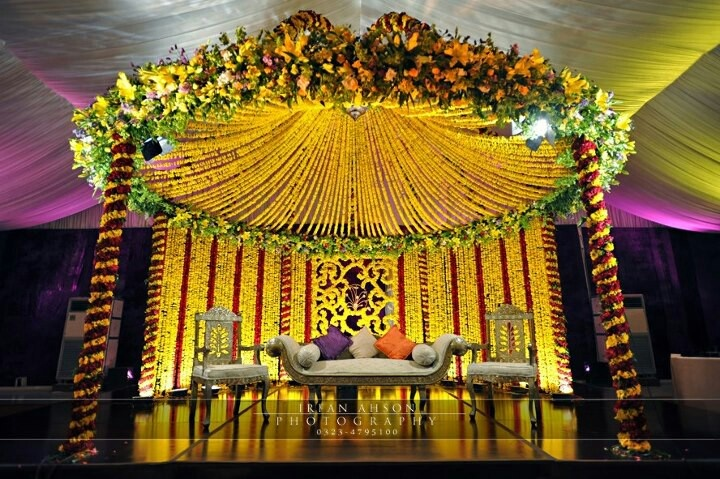 Mehndi stage | Yellow, pastel yellow, mustard yellow decor ...