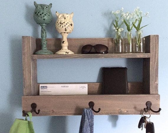 The amazing entryway shelf functions as a shelf, key holder, coat rack and mail organizer. It is made from reclaimed wood (pine) that has been