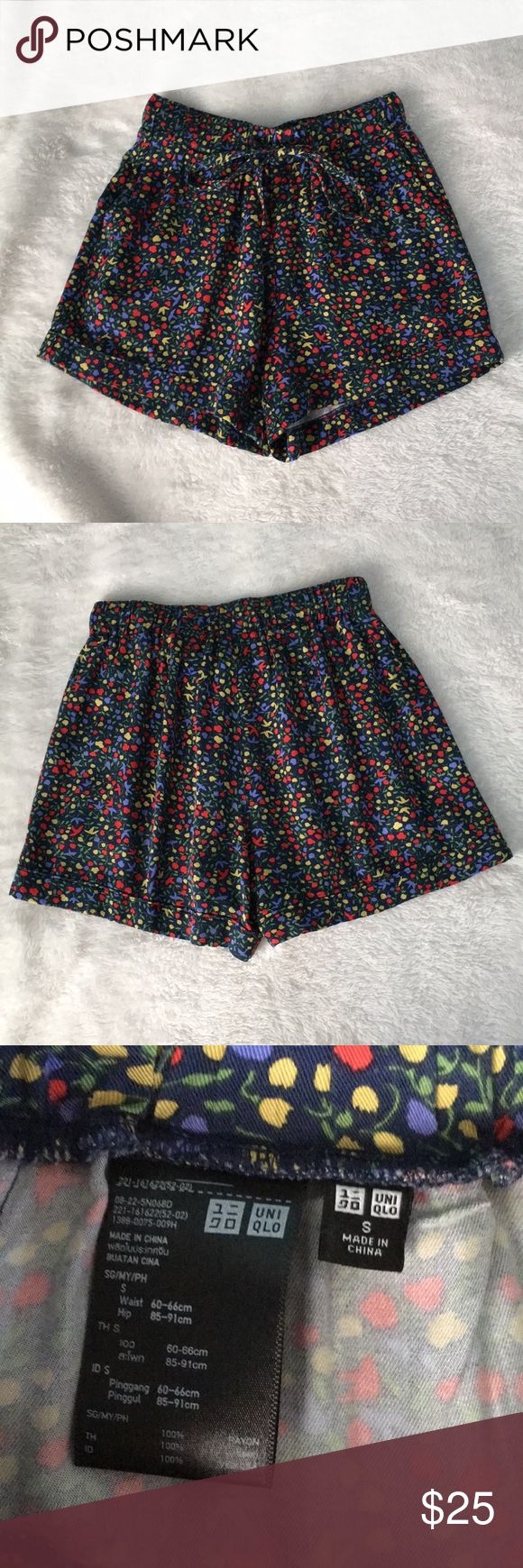 Cute floral patterned shorts from uniqlo Navy shorts with cute floral pattern. It has an adjustable drawstring and pockets. Size small. Only worn once Uniqlo Shorts