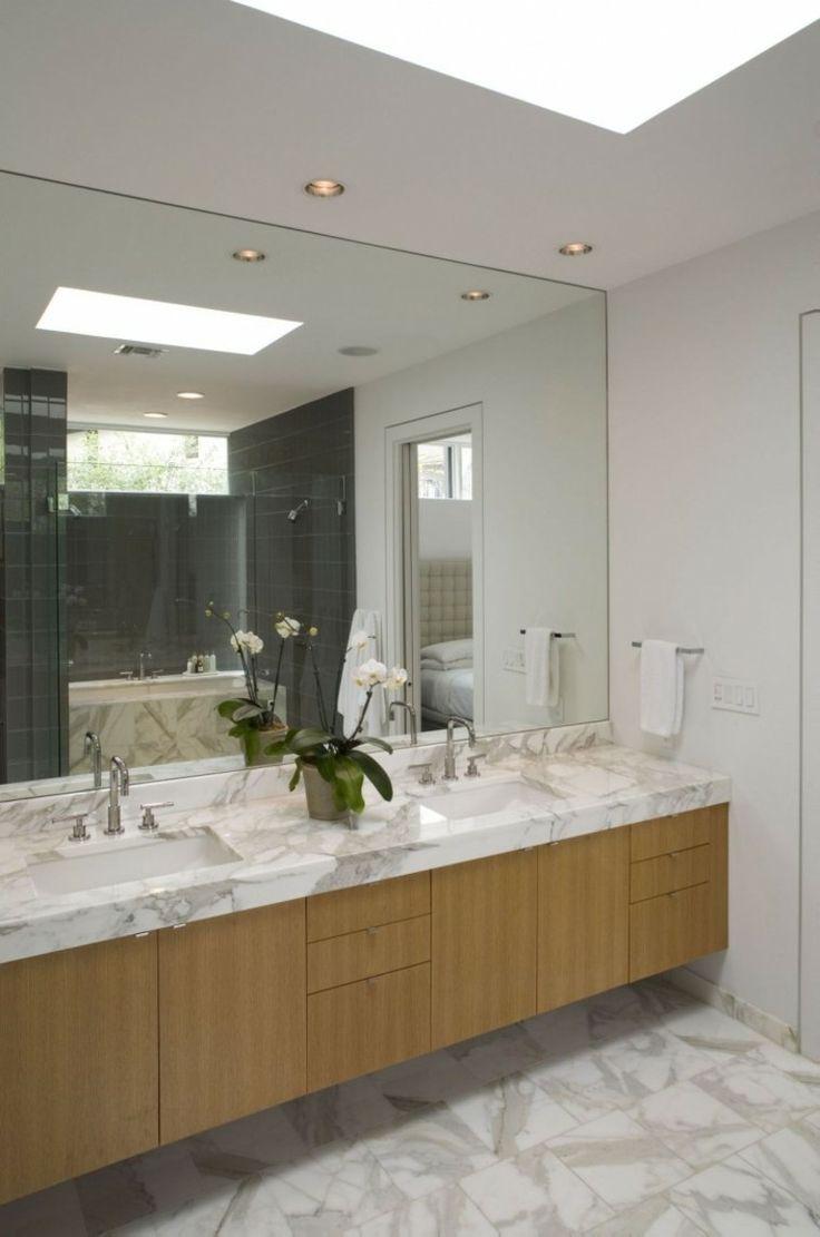 losas grises en el baño con lavabo de mármol