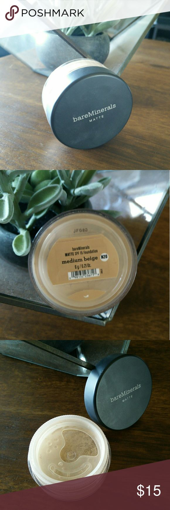 Medium beige matte foundation N20 Only used twice! Great coverage for mineral foundation with an SPF of 15. The matte finish helps control that extra shine from excess oil. Pairs well with mineral veil finishing powder layered over top. bareMinerals Makeup Foundation