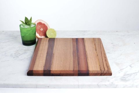 Re-purposed timber cutting board. Our Home Website - 300mm x 300mm  Beautiful and versatile laminated timber chopping, bread or cheese board made with timbers sourced exclusively from House 2067. Mixed timbers, including, Australian Hardwood, Cedar, Jarrah, Oregon and Oak.  Note: All boards retain characteristic elements of well seasoned + aged timber, making them truly unique.