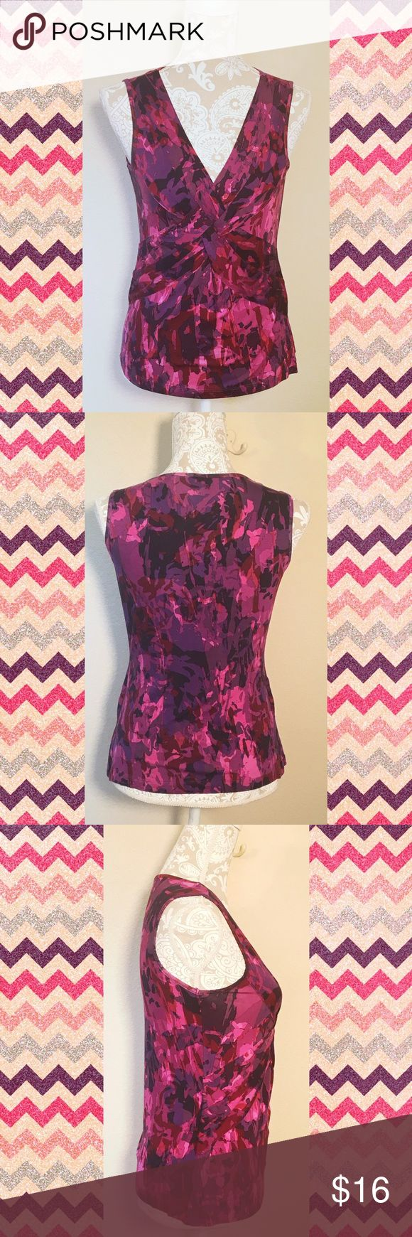 NWT Cable & Gauge knot V neck sleeveless blouse NWT Cable & Gauge V neck sleeveless purple & pink camouflage pattern front knot blouse. Size M. 97% viscose 3% spandex. Soft and stretchy. Brand new, no flaws, smoke free home. #purple #pink #medium #sleeveless #blouse #tank #vneck #stretch #cable ❌no trades❌ Cable & Gauge Tops Blouses