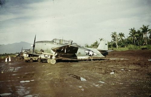 TBM-1C Avengers and an F4F Wildcat, probably with Marine squadrons, lined up at Dulag airstrip, Leyte, Philippines, c. 1944.