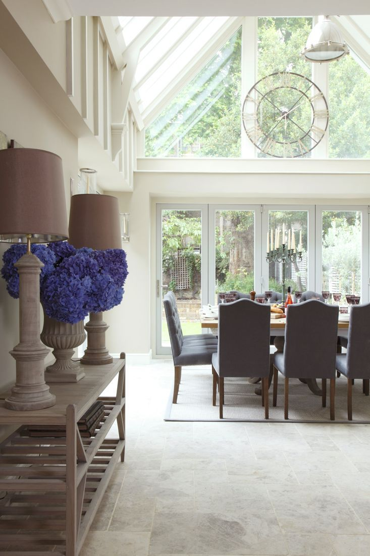 Gorgeous dining area that opens onto a courtyard..... & love the clock