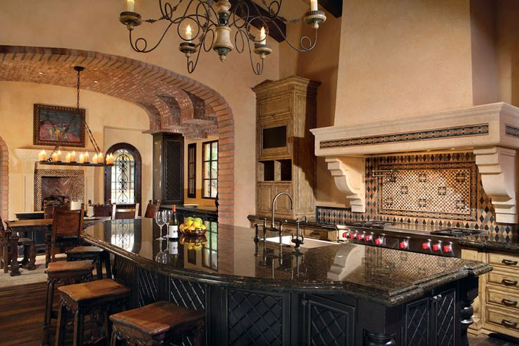 mediterranean-style-kitchen-with-exposed-brick-archway-rustic-dining-island