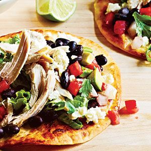 Chicken Tostadas - A snap to make for a busy weeknight meal. Brown tortillas in skillet then top with chicken, beans, lettuce, avocado & cheese.  Serve with your favorite salsa and/or sour cream.