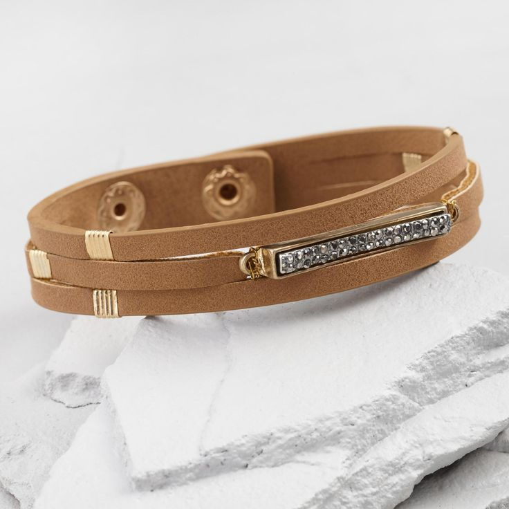 Featuring dashes of silver and the look of hematite stones, this tan leather bracelet is a little bit country and a little bit rock 'n' roll. It's the perfect accent for weekend festivals and beyond.