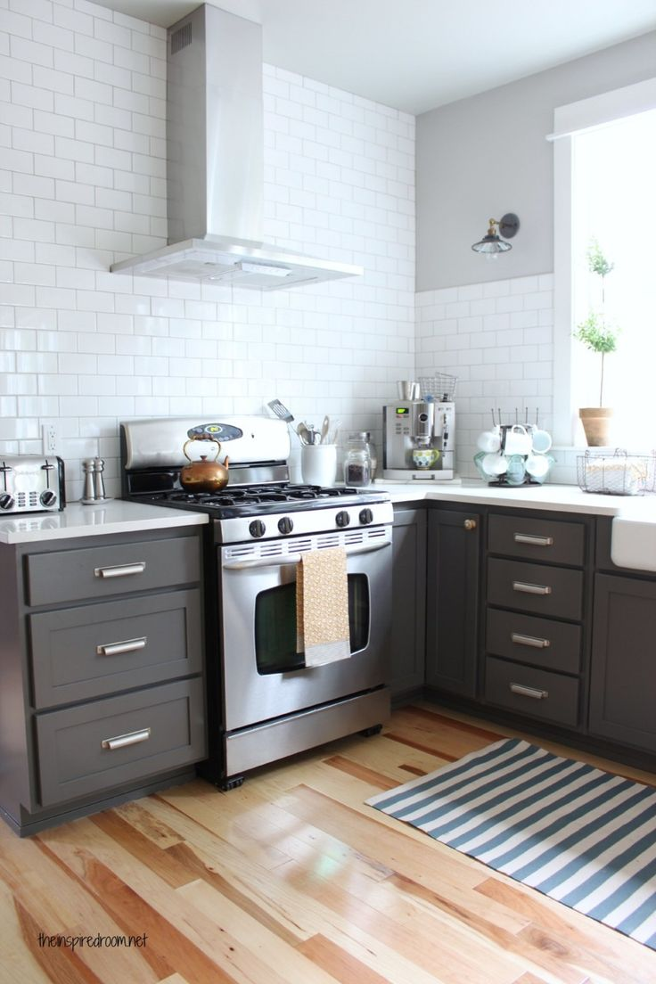 top 25 best subway edmonton ideas on pinterest i shaped kitchen kitchen remodel by the inspired room painted charcoal lower and white upper cabinets white subway tile and planked walls mixed polished nickel gold and