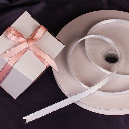 """If you're looking to personalize a ribbon, wrap a gift, or tie an almond sachet, look no further than Ruby Blanc's """"Satin & Silver"""" ribbons. The vibrant pop of white and stunning silver trim make this ribbon perfect for any occasion. Available in 15 colors!  #ribbons #partysupplies #crafts #partyribbons #crafting #giftwrapping #gifts #rubyblanc"""