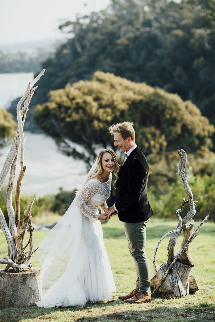 beach wedding south west uk%0A natural driftwood wedding backdrop