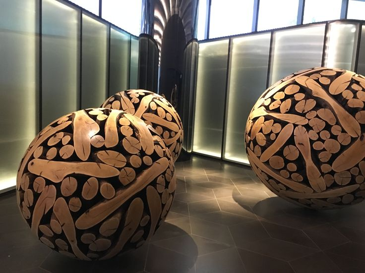 Photo 1: Artwork plays a vital role here - three large balls of burnt timber cut into perfect spheres by Korean artist Lee Jae-Hyo