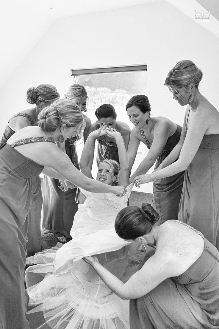 Bride Getting dress on with bridesmaids