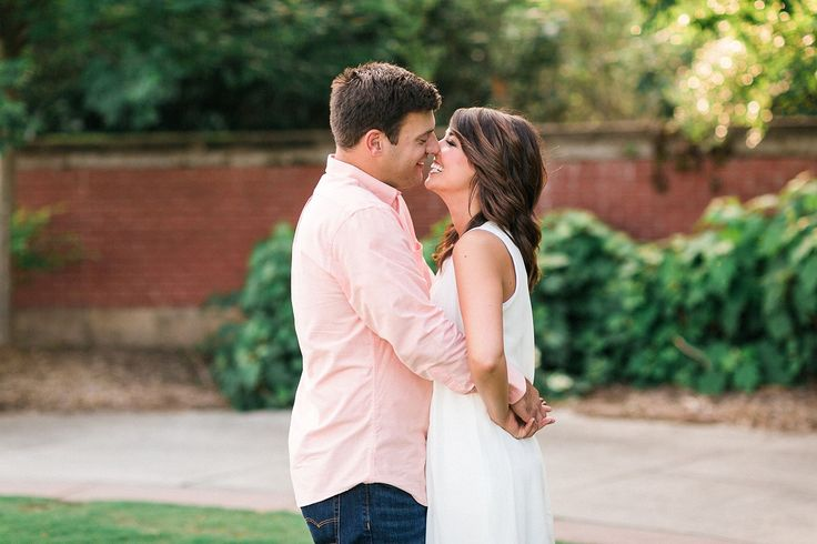 A white dress and a muted orange dress shirt is a perfect engagement photo combination for this Tennessee couple.    Neyland Stadium Engagement Session by Matthew Davidson Photography | Bride Link
