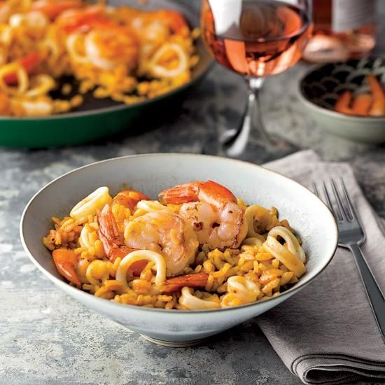 Smoky Paella with Shrimp and Squid | José Andrés prepares this satisfying rice dish with lots of seafood, including hard-to-find cuttlefish, and a house-made fish stock. To make it even easier, use squid in place of the cuttlefish, and skip the fish stock in favor of bottled clam broth from the supermarket.