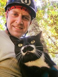 Photo courtesy of Shaun Sears/Canopy Cat Rescue. This wonderful man rescues cats stuck in trees.