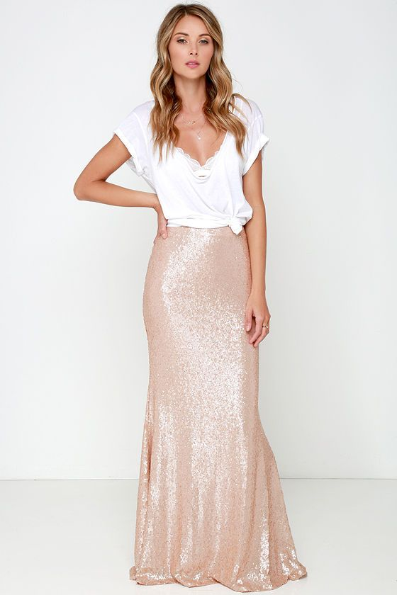 Take a trip to the moon and dance among the stars with the Kickin' Up Stardust Blush Sequin Maxi Skirt! Woven poly is decorated with a sea of sparkling blush sequins that bedazzle from the high fitted waist (with darting), down to the flaring maxi hem. Hidden zipper/hook clasp at back. Fully lined. 100% Polyester. Dry Clean Only.