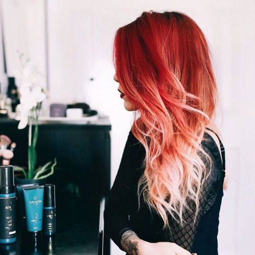 Red to strawberry blonde ombré... I wish I had the balls to do this I just can't give up my blonde