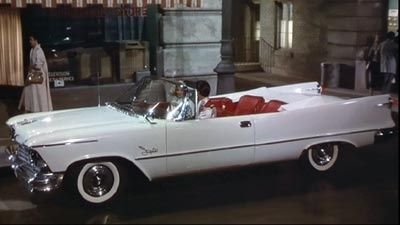 Elvis in the movie 'Loving You' driving a 1957 Chrysler ...