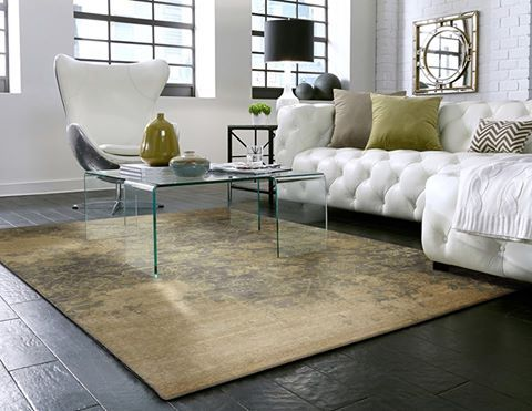 An Area Rug Defines The Conversation In This Living Space