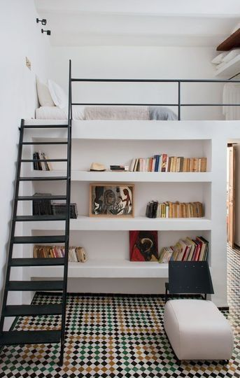 white lofted bed above bookshelves