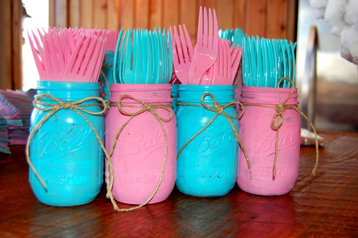 DIY Painted mason jars for a gender reveal party.