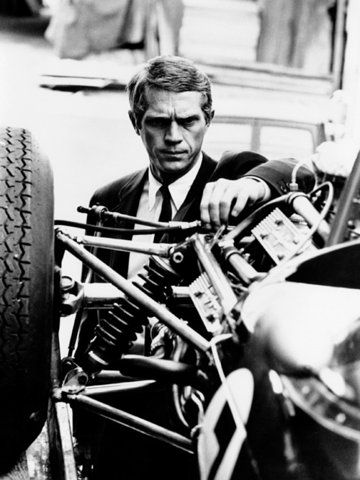 Just tuning my race car while wearing a suit. Just too cool.  Steve McQueen was one of the Coolest of our times.