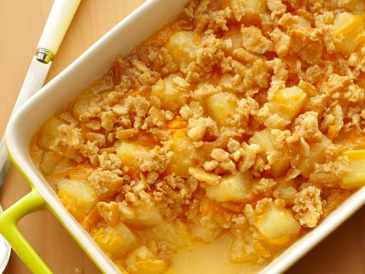 Pineapple Casserole from FoodNetwork.com - Toss strained pineapple with flour, sugar and Cheddar for a sweet side dish. The sweetness of the pineapple will complement a salty main dish.