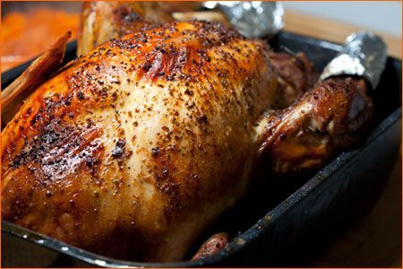 """Overnight 20-22lb Turkey. Made this today for the guys at the Air Force Base who worked Christmas Day. Turned out very moist. Will try again--cooked upside down, flipped back to """"right"""" for the ast 30-45 mins to brown. JUICY breast this way (heehee)."""