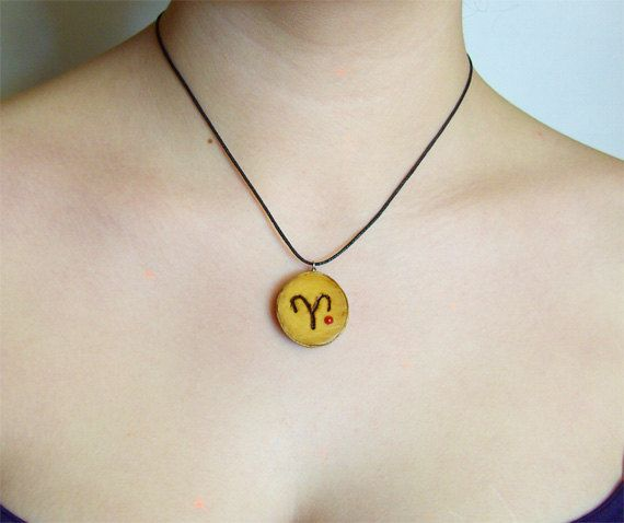 Genuine hand-made Olive Wood Aries Zodiac necklace, Genuine Coral. Black cord.