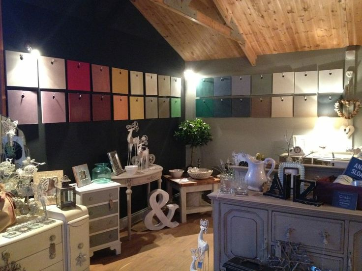 The interior of our shop... On walls painted in Graphite and Paris Grey is a board in every gorgeous colour of Chalk Paint™ decorative paint by Annie Sloan