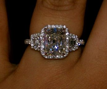 The only way I would ever want a 3 diamond engagement ring is if it looked like this