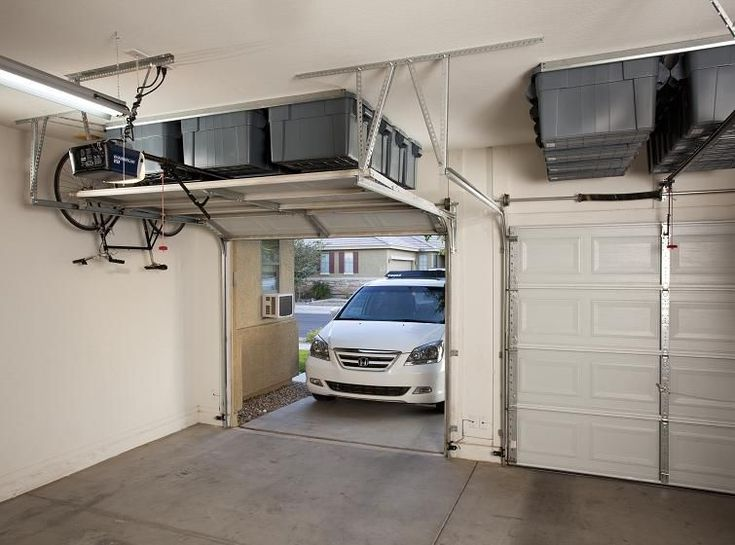 Takf rvaring garage pinterest garage design hidden for Over car garage storage