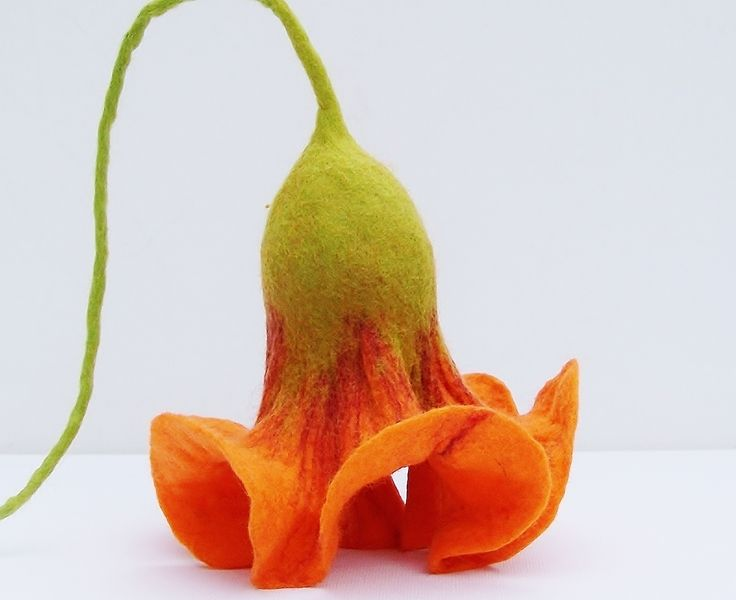 Very fresh from my felt table are a couple of grand, very romantic-looking, felted hanging flowers.  The hanging flower is in a lovely orange-red with