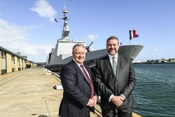 TWA-0045374 © WestPix Brent Clark of DCNS Australia which has been selected as the preferred partner to design Australia's $50 billion future submarines(left) with Commerce Minister Michael Mischin in front of the French Navy frigate Guepratte in Fremantle. Pic. Iain Gillespie The West Australian
